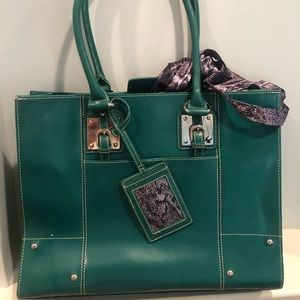 Green leather bag with cloth interior, & dust bag